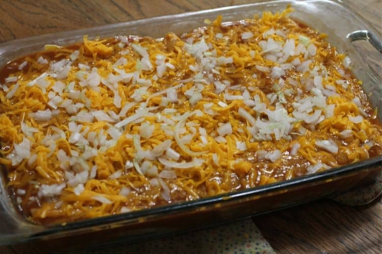 image of an uncooked pan of chicken enchiladas