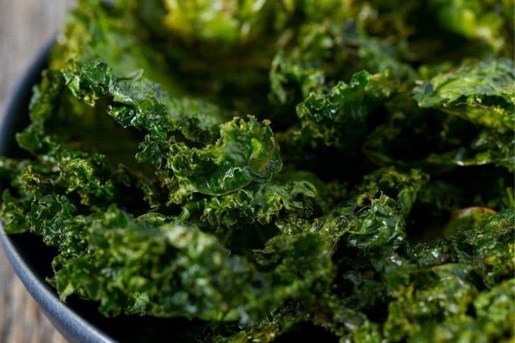 crispy kale chips in a blue bowl