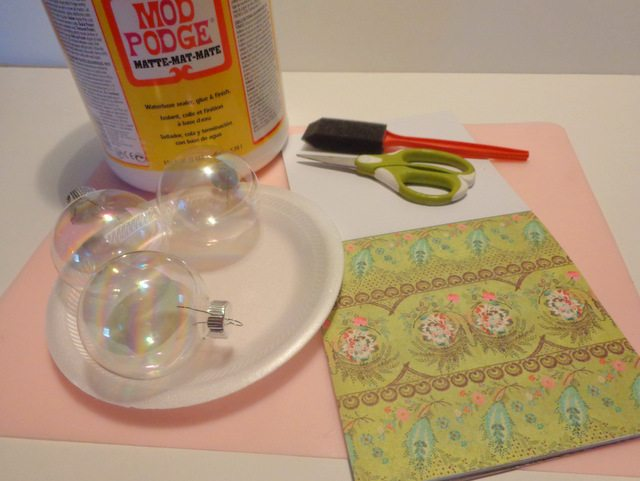 image of craft paper, mod podge, clear Christmas balls, sponge paint brush, scissors
