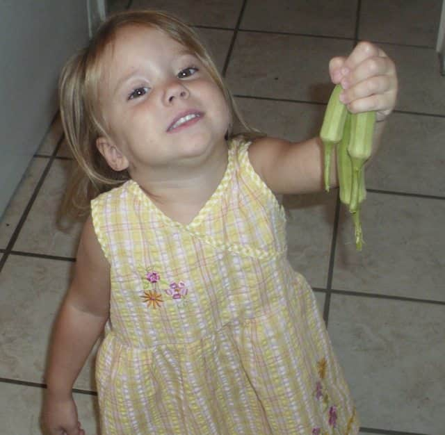 Toddler with okra