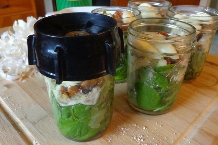 image of pesto ingredients in jar for blending and freezing
