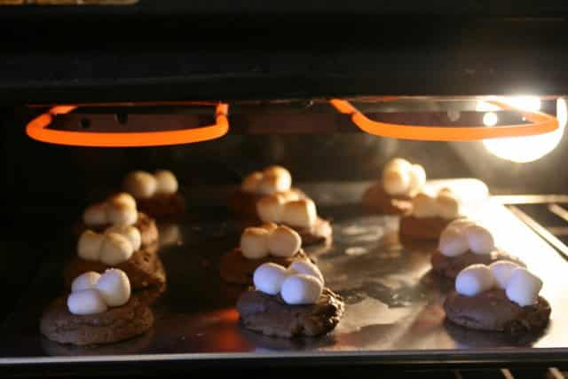 toasting marshmallows on cookies