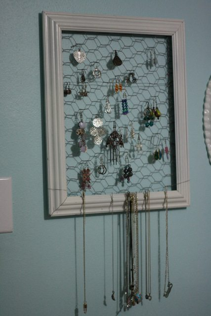 image of earring holder made out of a picture frame and chicken wire