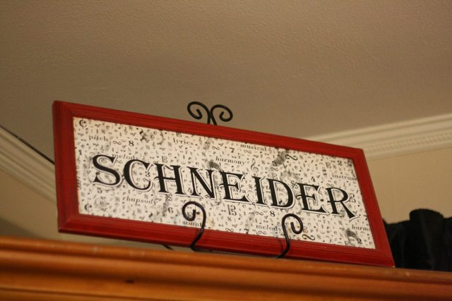 image of sign that has the last name Schneider on it.