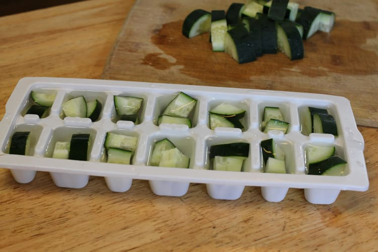 photo of cucumber chunks in ice cube trays for freezing