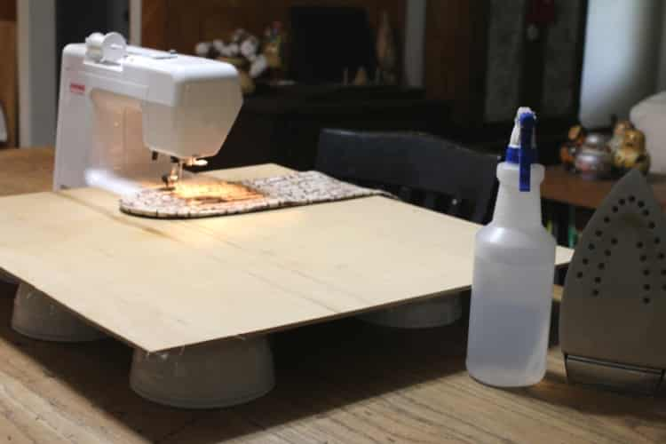 image of homemade sewing machine extension with plywood and bowls