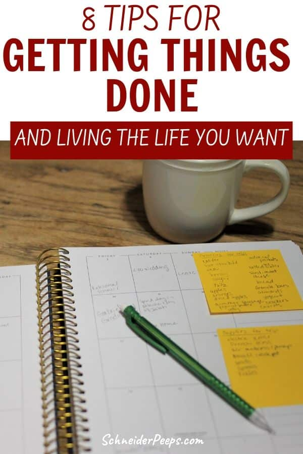 image of paper planner with writing and cup of coffee.