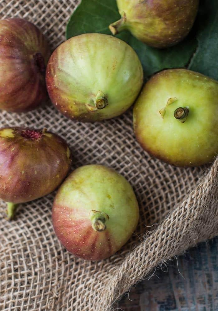 Image of ripe brown turkey figs on burlap fabric