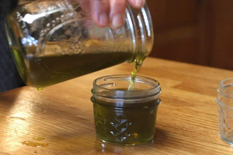 image of pouring herbal salve into mason jars