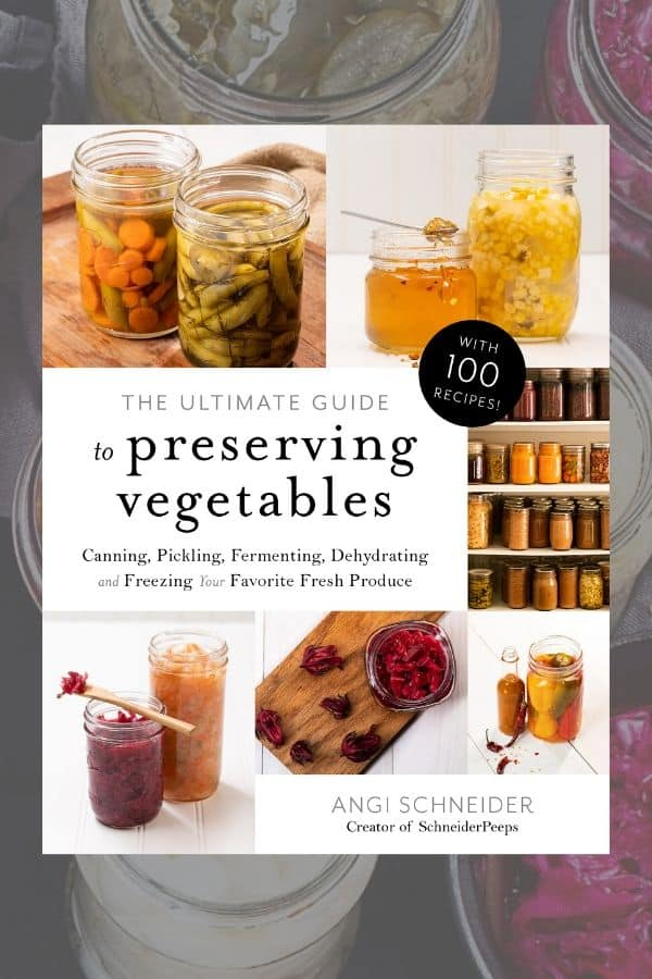 Image of The Ultimate Guide to Preserving Vegetables book with jars of canned and fermented food.