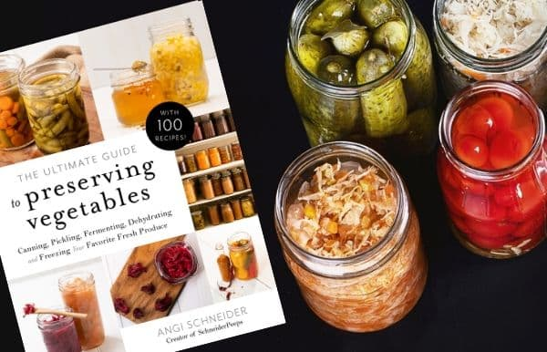 image of the book The Ultimate Guide to Preserving Vegetables and mason jars with canned and fermented food in them