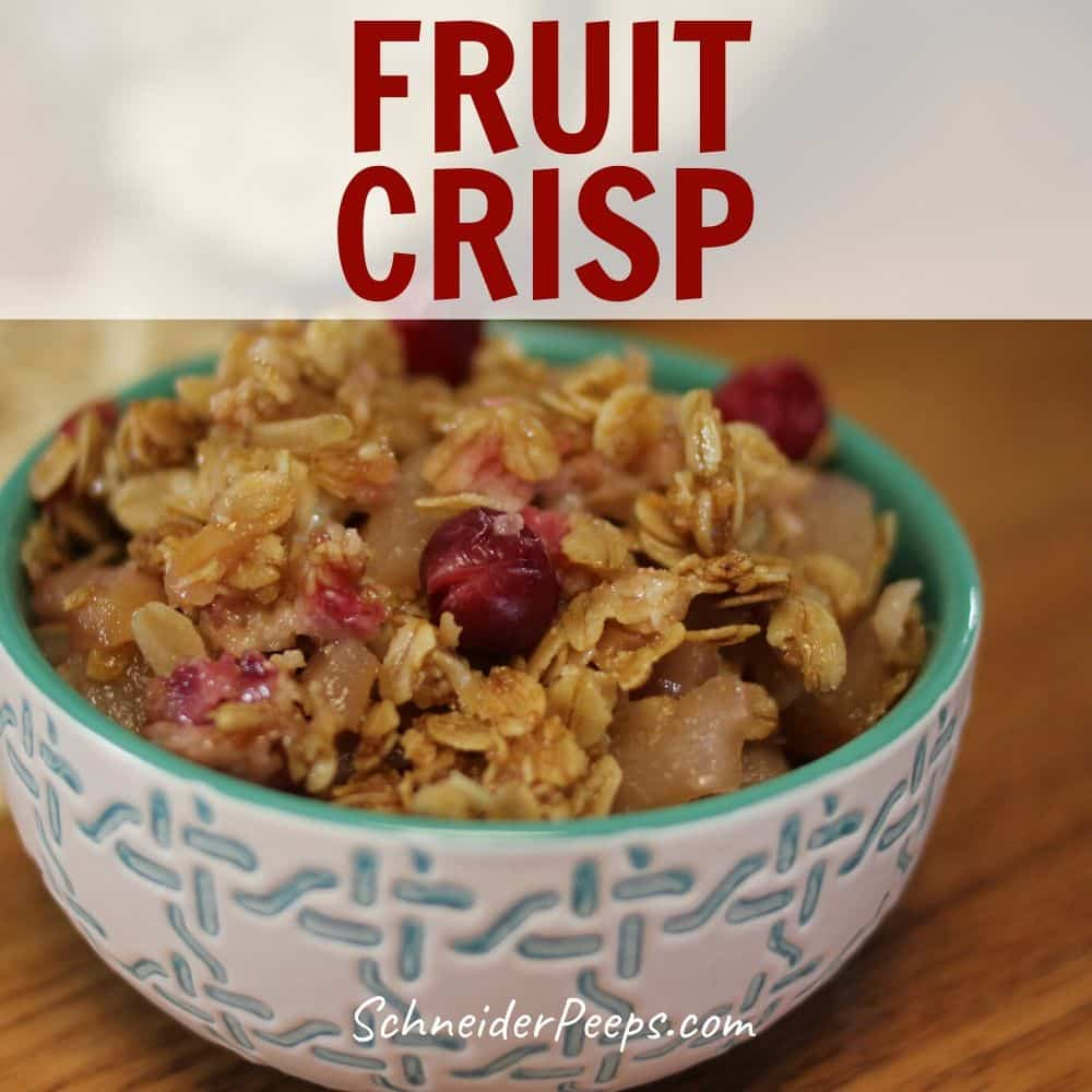 image of pear cranberry fruit crisp in white and teal bowl