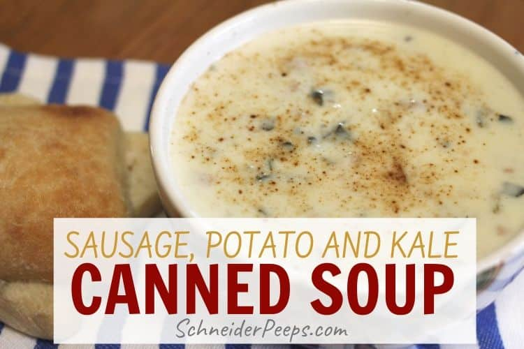 bowl of creamy sausage potato soup on blue and white striped kitchen towel