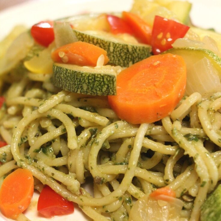 pesto pasta with carrots, squash, zucchini, onions and tomatoes