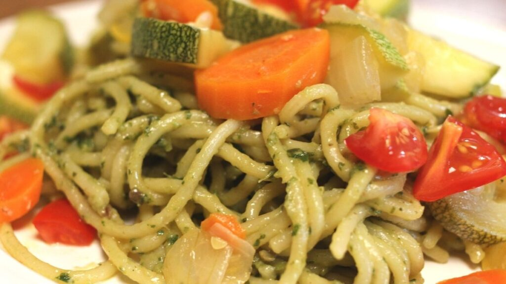 This summer vegetable pesto pasta dish is loaded with garden fresh vegetables such as yellow squash, zucchini, carrots, onions, and tomatoe